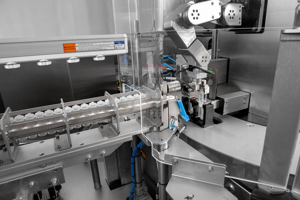 In this example, Mecademic's robot arm is assembling the plunger of a syringe as part of a complex automated system (image courtesy of GTE)